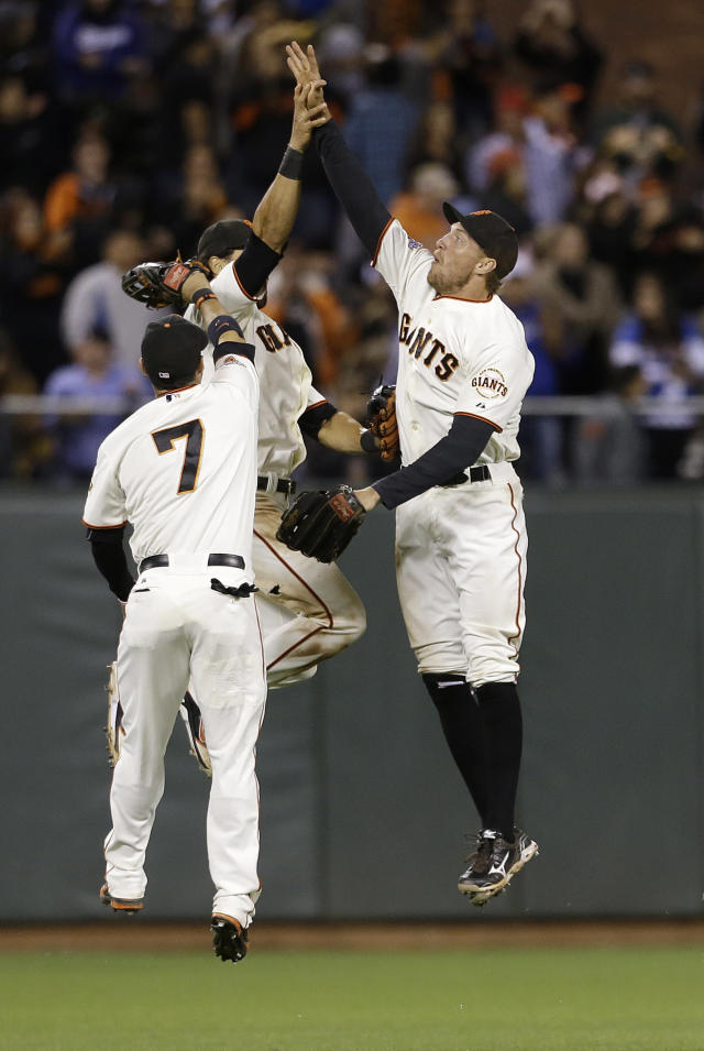 San Francisco Giants center fielder Gregor Blanco (7), center fielder Angel Pagan, rear, and right fielder Hunter Pence celebrate after the Giants beat the Los Angeles Dodgers in a baseball game in San Francisco, Wednesday, Sept. 25, 2013. The Giants won 6-4. (AP Photo/Jeff Chiu)