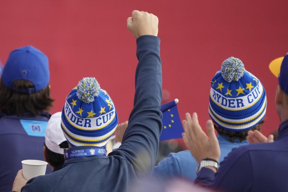 Team Europe fans cheer during the opening ceremony for the Ryder Cup at the Whistling Straits Golf Course Thursday, Sept. 23, 2021, in Sheboygan, Wis. (AP Photo/Charlie Neibergall)