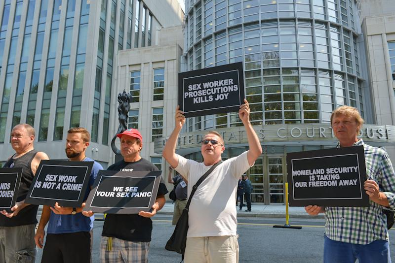 Activists protest a raid against a male escort service outside the federal courthouse in Brooklyn in August 2015.