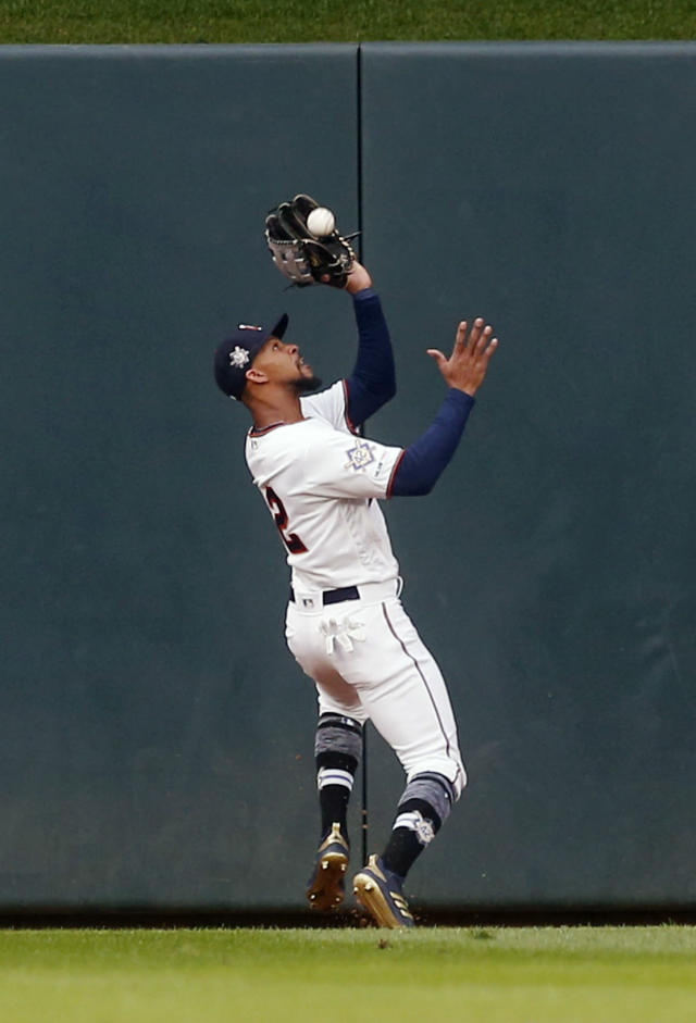 Minnesota Twins center fielder Byron Buxton fields a long fly ball off the bat of Toronto Blue Jays' Billy McKinney in the first inning of a baseball game Monday, April 15, 2019, in Minneapolis. (AP Photo/Jim Mone)