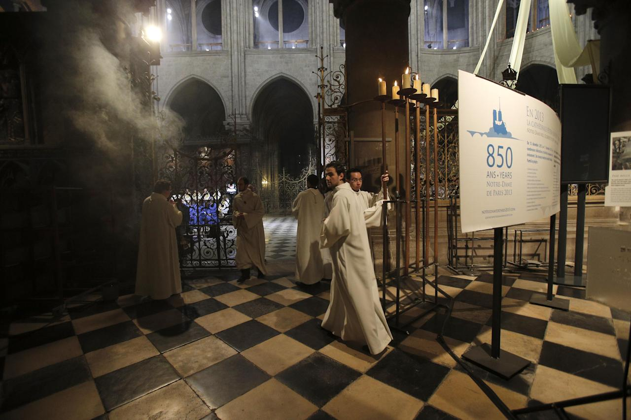Religious dignitaries attend a ceremony at Paris' Notre Dame Cathedral for its 850th anniversary , Wednesday, Dec. 12, 2012. Paris' Notre Dame Cathedral is kicking off its 850th anniversary celebrations, which will include new bells for the medieval landmark, cast in a foundry in Normandy. (AP Photo/Christophe Ena)