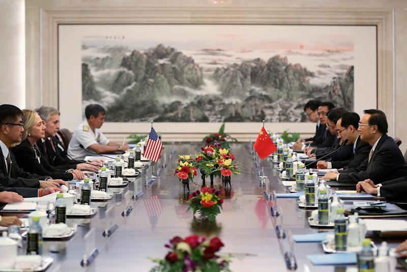 U.S. Secretary of State Hillary Clinton, second from left, meets with Chinese Foreign Minister Yang Jiechi, right, during her visit to Beijing, Tuesday, Sept. 4, 2012. Clinton is in Beijing to press Chinese authorities to agree to peacefully resolve disputes with their smaller neighbors over competing territorial claims in the South China Sea. (AP Photo/Feng Li, Pool)