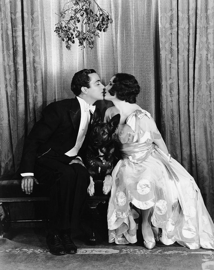 <p>Silent film star Buddy Rogers went white-tie for holiday festivities in 1929. The actor shares a kiss under the mistletoe with famous '20s actress, Mary Brian. </p>