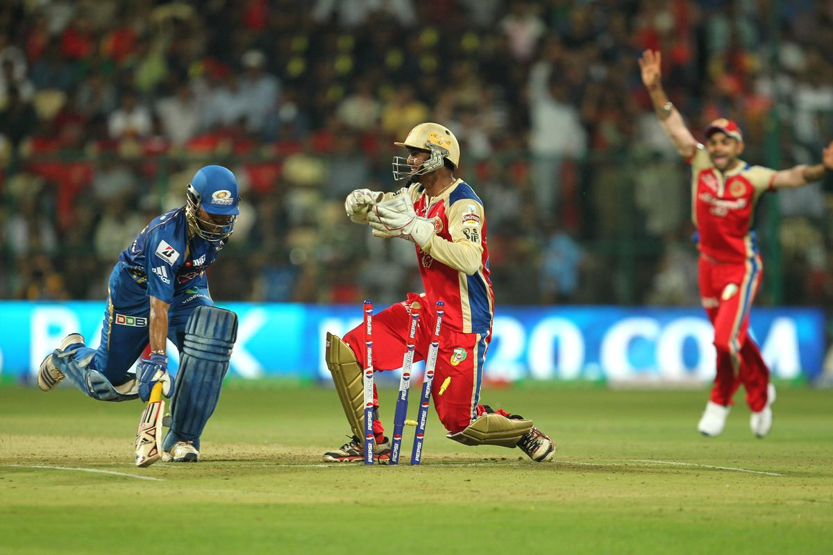Sachin Tendulkar gets run out during match 2 of of the Pepsi Indian Premier League between The Royal Challengers Bangalore and The Mumbai Indians held at the M. Chinnaswamy Stadium, Bengaluru on the 4th April 2013Photo by Prashant BhootSPORTZPICS Use of this image is subject to the terms and conditions as outlined by the BCCI. These terms can be found by following this link:https://ec.yimg.com/ec?url=http%3a%2f%2fwww.sportzpics.co.za%2fimage%2fI0000SoRagM2cIEc&t=1490292399&sig=l8P65R5awwTf_ivFJ_6dTQ--~C