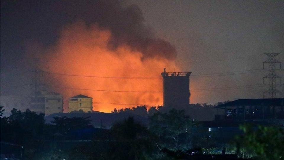 Burning Chinese-owned factories light up the industrial neighbourhood in Hlaing Tharyar, on the outskirts of Yangon, Myanmar, 15 March 2021