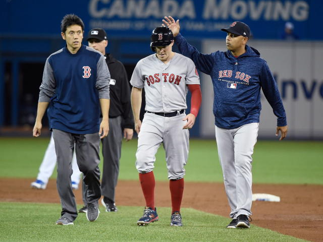 Boston Red Sox second baseman Brock Holt leaves the game with an injury during the third inning of the team's baseball game against the Toronto Blue Jays in Toronto on Thursday, April 26, 2018. (Nathan Denette/The Canadian Press via AP)