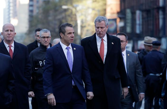 New York Gov. Andrew Cuomo, center, and Bill de Blasio arrive for a news conference outside the Port Authority Bus Terminal in New York City. (Photo: Mark Lennihan/AP)