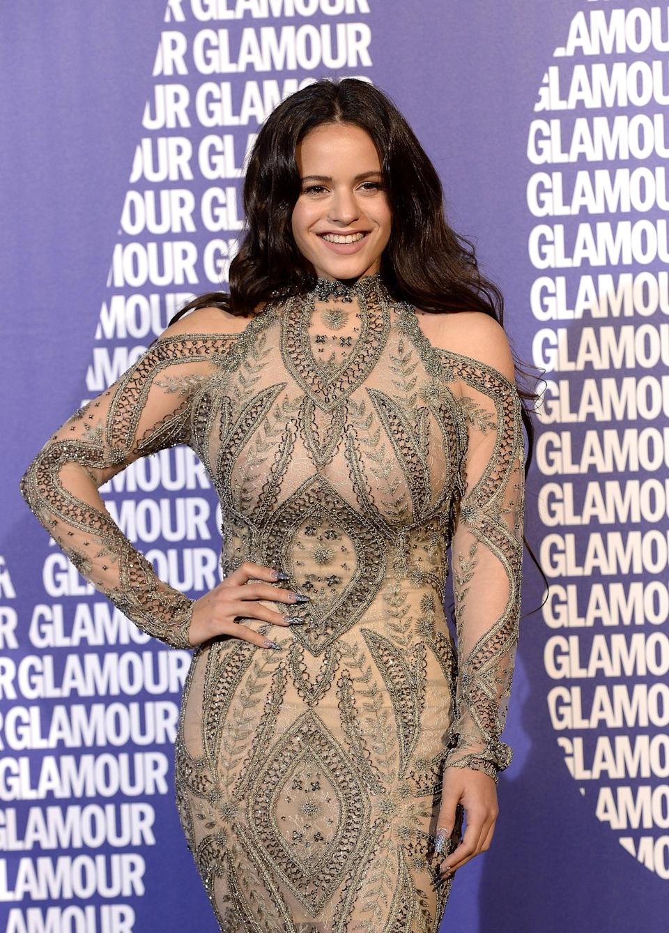 <p>Rosalía went for a very subtle makeup look and curled her hair into glamourous waves. </p>
