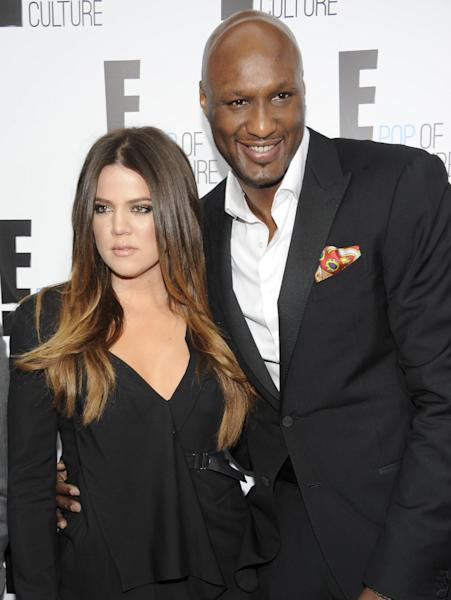 """FILE - In this April 30, 2012 file photo, Khloe Kardashian Odom and Lamar Odom pose at an E! Network event in New York. Odom is breaking his silence with his first post on Twitter since the NBA star was arrested and charged with driving under the influence last month. Odom tweeted """"Seeing the snakes"""" on Tuesday night, Sept. 24, 2013, in his first post since his Aug. 30 arrest. (AP Photo/Evan Agostini, File)"""