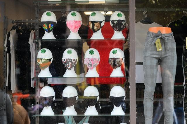 Assorted colourful face coverings for sale in a shop window in Nottingham city centre (Mike Egerton/PA)
