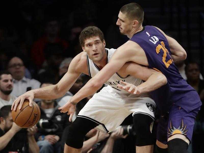The Nets' Brook Lopez has one year left on his contract, and the Suns' Alex Len will be a restricted free agent. (AP)