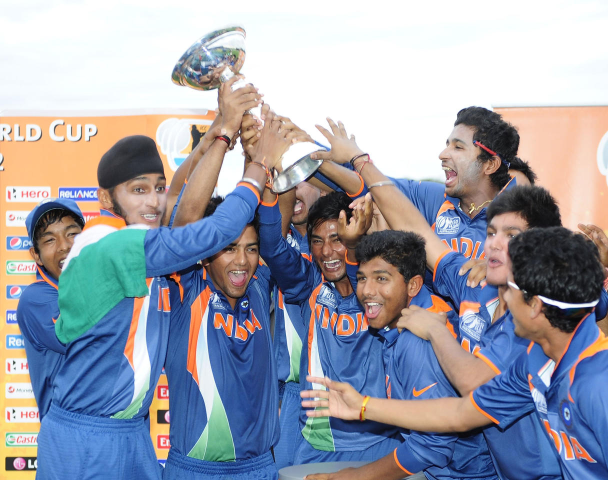 TOWNSVILLE, AUSTRALIA - AUGUST 26:  Indian players celebrate winning the 2012 ICC U19 Cricket World Cup Final between Australia and India at Tony Ireland Stadium on August 26, 2012 in Townsville, Australia.  (Photo by Ian Hitchcock-ICC/Getty Images)