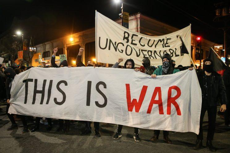 People protesting controversial Breitbart writer Milo Yiannopoulos take to the streets in Berkeley on Wednesday night. (Elijah Nouvelage/Getty Images)