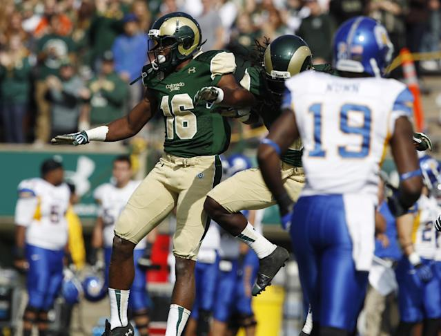 Colorado State safety Trent Matthews, back, left, celebrates his interception of a pass with defensive back Shaq Bell, back right, as San Jose State wide receiver Kyle Nunn looks on in the first quarter of an NCAA college football game in Fort Collins, Colo., on Saturday, Oct. 12, 2013. (AP Photo/David Zalubowski)