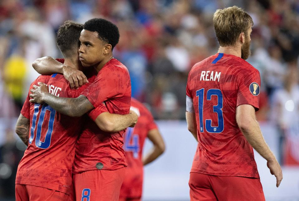 USA's Christian Pulisic (L) and Wesdtron McKennie (C) celebrate their 3-1 victory over Jamaica at the end of their 2019 Concacaf Gold Cup semifinal football match on July 3, 2019 in Nashville, Tennessee. (Photo by Jim WATSON / AFP)        (Photo credit should read JIM WATSON/AFP/Getty Images)