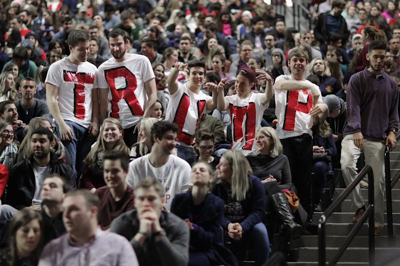 """Liberty University students wear homemade T-shirts spelling """"TRUMP"""" while waiting for the arrival of then-candidate Donald Trump during a campaign rally at Liberty University on Jan. 18, 2016, in Lynchburg, Virginia. (Photo: Chip Somodevilla via Getty Images)"""