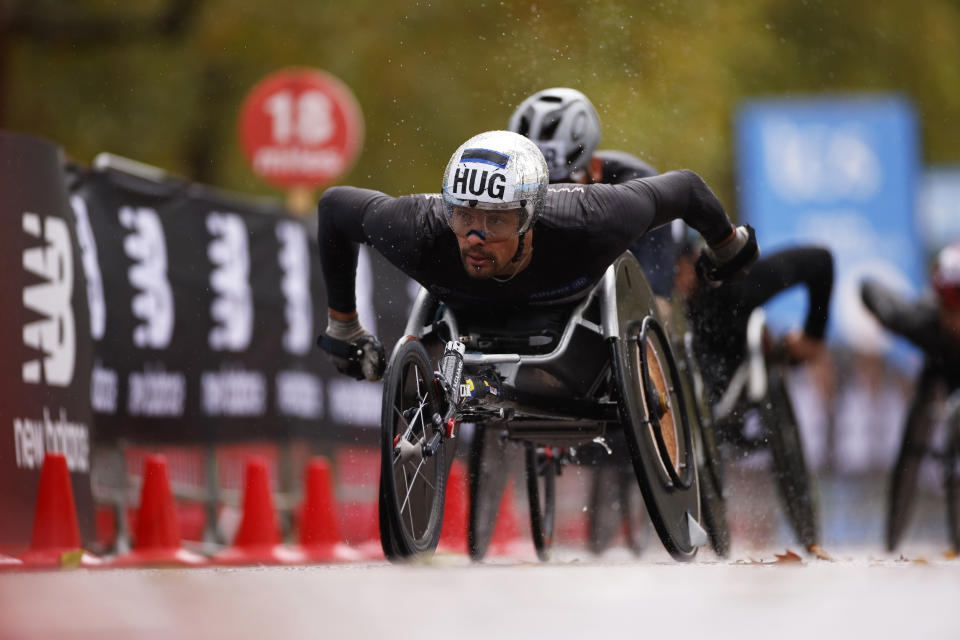 LONDON, ENGLAND - OCTOBER 04: Marcel Hug of Switzerland competes in the Wheelchair race during the 2020 Virgin Money London Marathon around St. James's Park on October 04, 2020 in London, England. The 40th Race will take place on a closed-loop circuit around St. James's Park in central London. (Photo by John Sibley - Pool/Getty Images)
