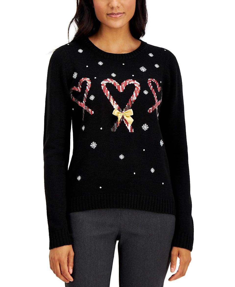 <p>This sweet <span>Karen Scott Sequin Candy Cane Heart Sweater</span> ($25, originally $50) will keep you warm when the temperatures dip.</p>