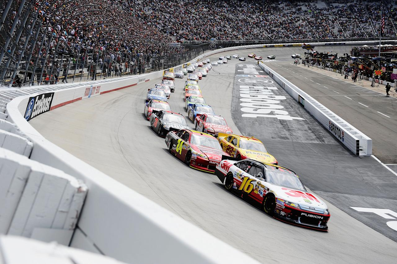 BRISTOL, TN - MARCH 18:  Greg Biffle, driver of the #16 3M/811 Ford, leads the feild past the green flag to start the NASCAR Sprint Cup Series Food City 500 at Bristol Motor Speedway on March 18, 2012 in Bristol, Tennessee.  (Photo by Jared C. Tilton/Getty Images)