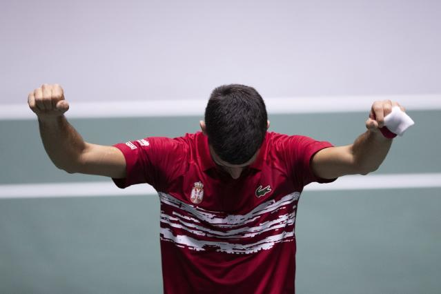 Serbia's Novak Djokovic celebrates after winning Japan's Yoshihito Nishioka during their Davis Cup tennis match in Madrid, Spain, Wednesday, Nov. 20, 2019. (AP Photo/Bernat Armangue)