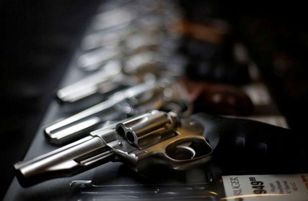 PHOTO: In this Dec. 21, 2108, file photo, handguns for sale are lined up in a display case in a gun shop. (Charlie Riedel/AP, FILE)