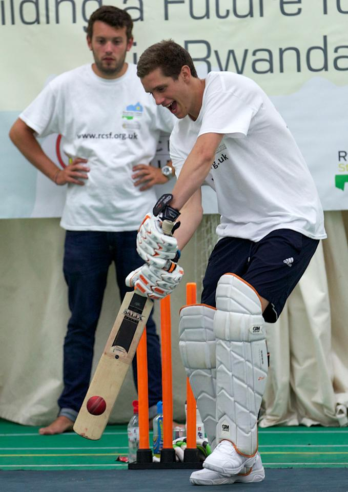 Alby Shale (R) bats at the Oval cricket club in London, on July 16, 2013. A British graduate collapsed in a heap on Tuesday at The Oval cricket ground in London after batting for 26 hours in a bid to break the world record. The attempt was in aid of the Rwanda Cricket Stadium Foundation -- a charity set up to build the first proper cricket ground in the African country. AFP PHOTO / ANDREW COWIE