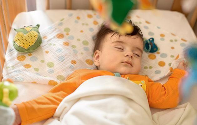 Avoid too many toys around your baby's cot. Photo: Getty