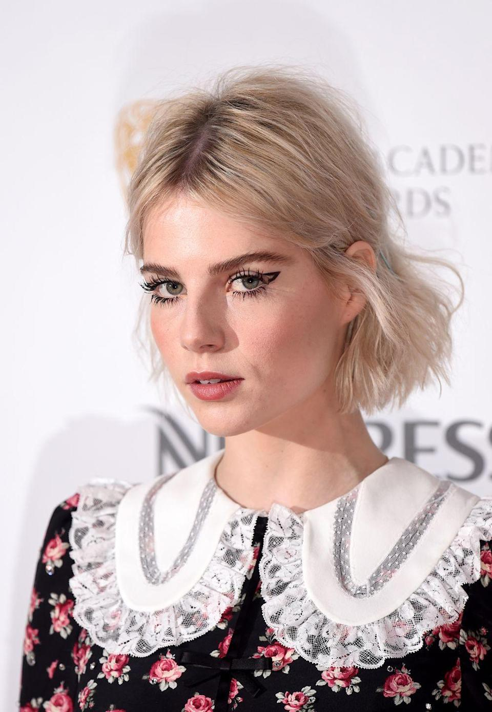 <p>How to do your eyeliner in way less time? Go for negative space 'arrows' a la Lucy Boynton.</p>