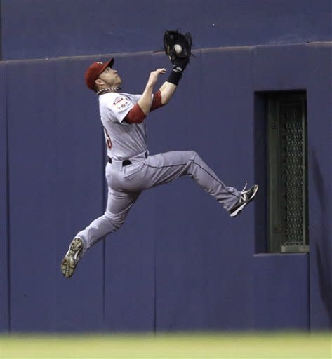 Houston Astros' Steve Pearce makes a leaping catch on a ball hit by Milwaukee Brewers' Corey Hart during the sixth inning of a baseball game Monday, July 30, 2012, in Milwaukee. (AP Photo/Jeffrey Phelps)