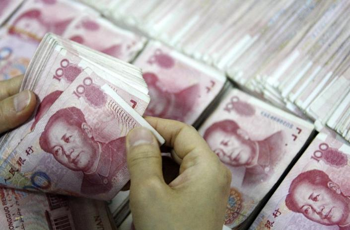 Sovereign wealth fund China Investment Corp was created in 2007 with $200 billion to make better use of China's colossal foreign exchange reserves, which amounted to $3.73 trillion this March (AFP Photo/Str)