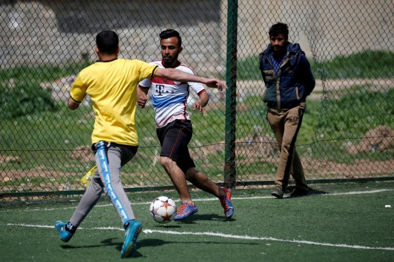 Now that eastern Mosul has been recaptured from IS jihadists, efforts are underway to rehabilitate football pitches, even as the battle for the Iraqi city's west continues on the other side of the Tigris River