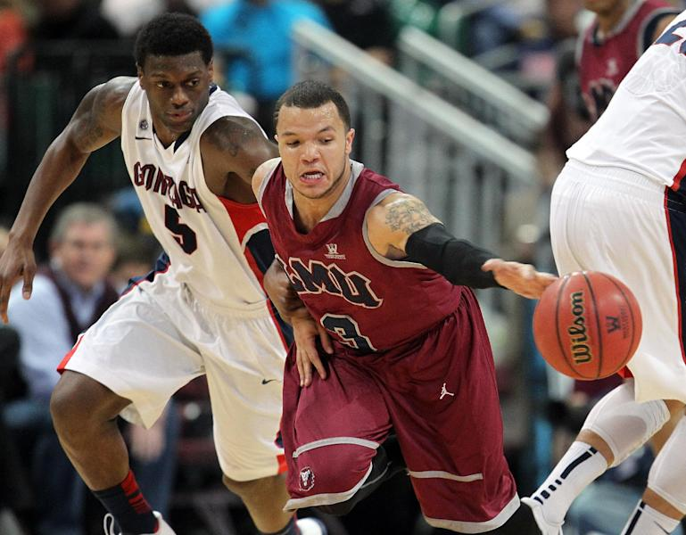 Gonzaga's Gary Bell Jr., left, and Loyola Marymount's Anthony Ireland go after a loose ball during the first half of a West Coast Conference tournament NCAA college basketball game on Saturday, March 9, 2013, in Las Vegas. (AP Photo/Isaac Brekken)