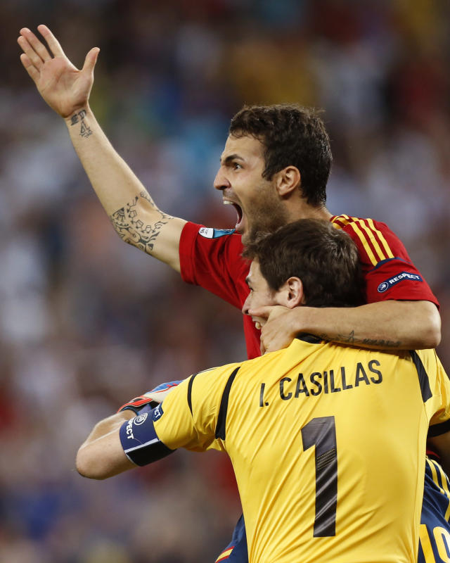 Spain's Cesc Fabregas celebrates with his teammate Iker Casillas after scoring the decisive penalty shootout during the Euro 2012 soccer championship semifinal match between Spain and Portugal in Donetsk, Ukraine, Thursday, June 28, 2012. (AP Photo/Jon Super)