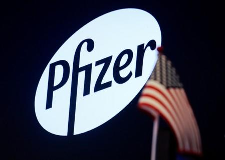 A logo for Pfizer is displayed on a monitor on the floor at the NYSE in New York