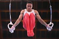 <p>Britain's Joe Fraser competes in the rings event of the artistic gymnastics men's team final.</p>