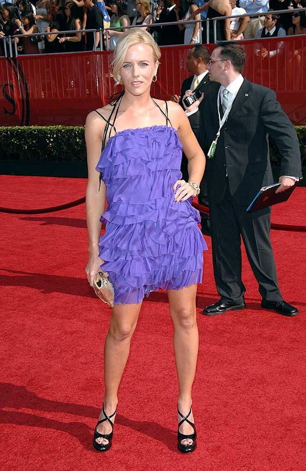 "Surfer Hannah Cornett popped a pose in a sexy purple cocktail dress. Stephen Shugerman/<a href=""http://www.gettyimages.com/"" target=""new"">GettyImages.com</a> - July 16, 2008"