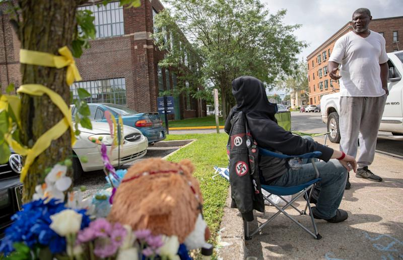 Tyree Bonds (right), brother of Eric Logan, talks with an anonymous man guarding a memorial for Logan in South Bend, Monday, June 24, 2019. The city, home to Presidential hopeful Pete Buttigieg, is where black resident Logan was recently shot and killed by police, causing some to take issue with the way Buttigieg's administration has handled the shooting and other issues of crime and poverty in the city.