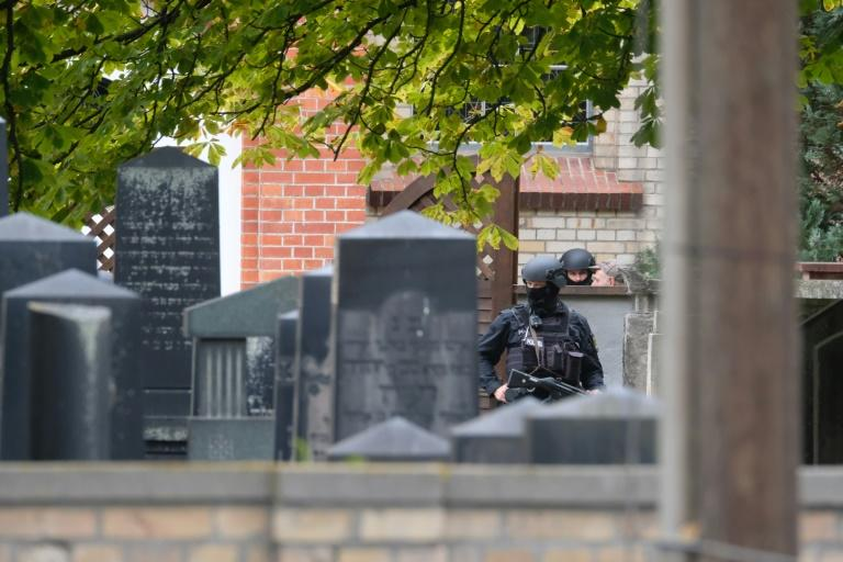 Police ordered residents to stay inside and close all doors and windows after the attack (AFP Photo/Sebastian Willnow)