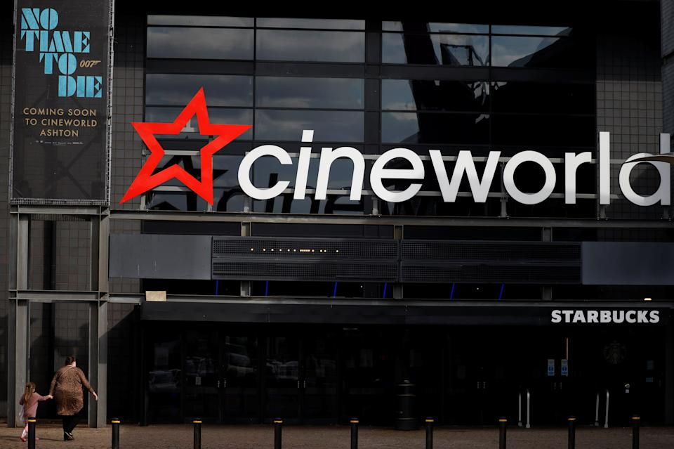 A poster for the new James Bond film 'No time to die' is seen outside a Cineworld cinema following the outbreak of the coronavirus disease (COVID-19) near Manchester, Britain, October 4, 2020. REUTERS/Phil Noble