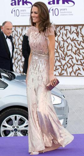 Kate dazzles in a sequined pink Jenny Packham gown at the 10th Annual ARK (Absolute Return for Kids) Gala Dinner on June 9. The dress is embellished with Swarovski crystals and layers of tulle on the shoulders. She has never looked more like a Duchess than here. (Samir Hussein/WireImage.com)