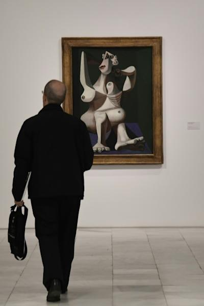 "The exhibition includes such works by Pablo Picasso as ""Woman Dressing her Hair"" to show a turn in the artist's work to the more macabre"
