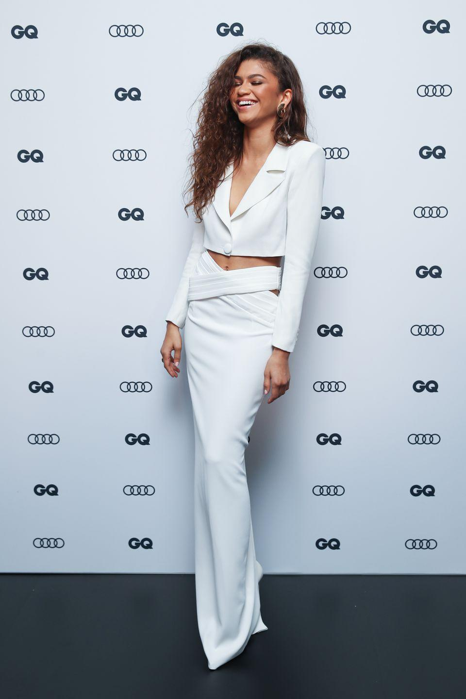 <p>At <em>GQ</em>'s 2019 Man of the Year Awards, she stepped out in *the* outfit of the night (if we do say so ourselves). This white jacket and skirt combo by Mônot paired with her gorge curls created the perfect red carpet look.</p>