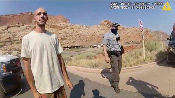 PHOTO: This police camera video provided by The Moab Police Department shows Brian Laundrie talking to a police officer after police pulled over the van he was traveling in near the entrance to Arches National Park on Aug. 12, 2021 (The Moab Police Department via AP)