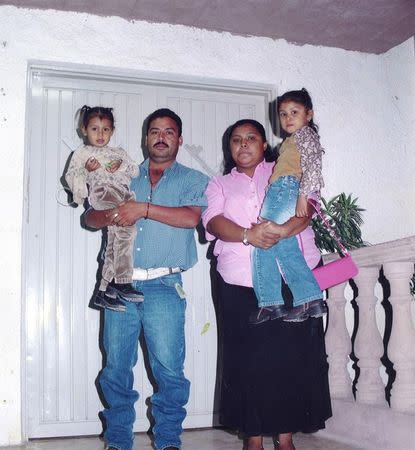 Guillermo Arevalo Pedraza (2nd L) poses with his wife and daughters in an undated photo released by his family in Nuevo Laredo, Mexico. REUTERS/Family of Guillermo Arevalo Pedraza/Handout via Reuters