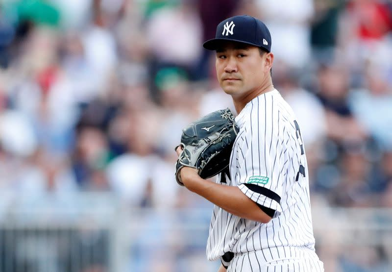 Yankees' Tanaka hit in head by Stanton line drive
