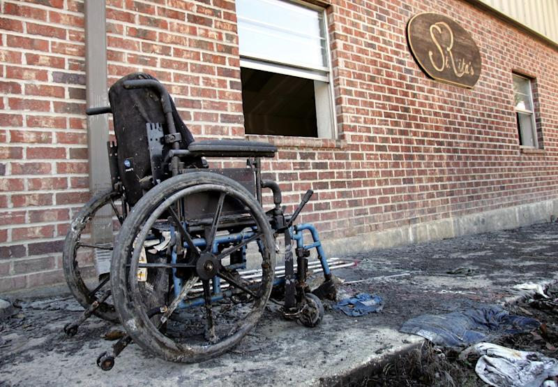 """FILE - In this Oct 23, 2005, file photo a wheelchair sits outside St. Rita's Nursing Home in St. Bernard's Parish, La., after Hurricane Katrina. Nearly seven years after the hurricane exposed the vulnerability of nursing homes, serious shortcomings persist. """"We identified many of the same gaps in nursing home preparedness and response,"""" investigators from the inspector general's office of the Department of Health and Human Services wrote in the report being released Monday, April 16, 2012. (AP Photo/Robert F. Bukaty, File)"""