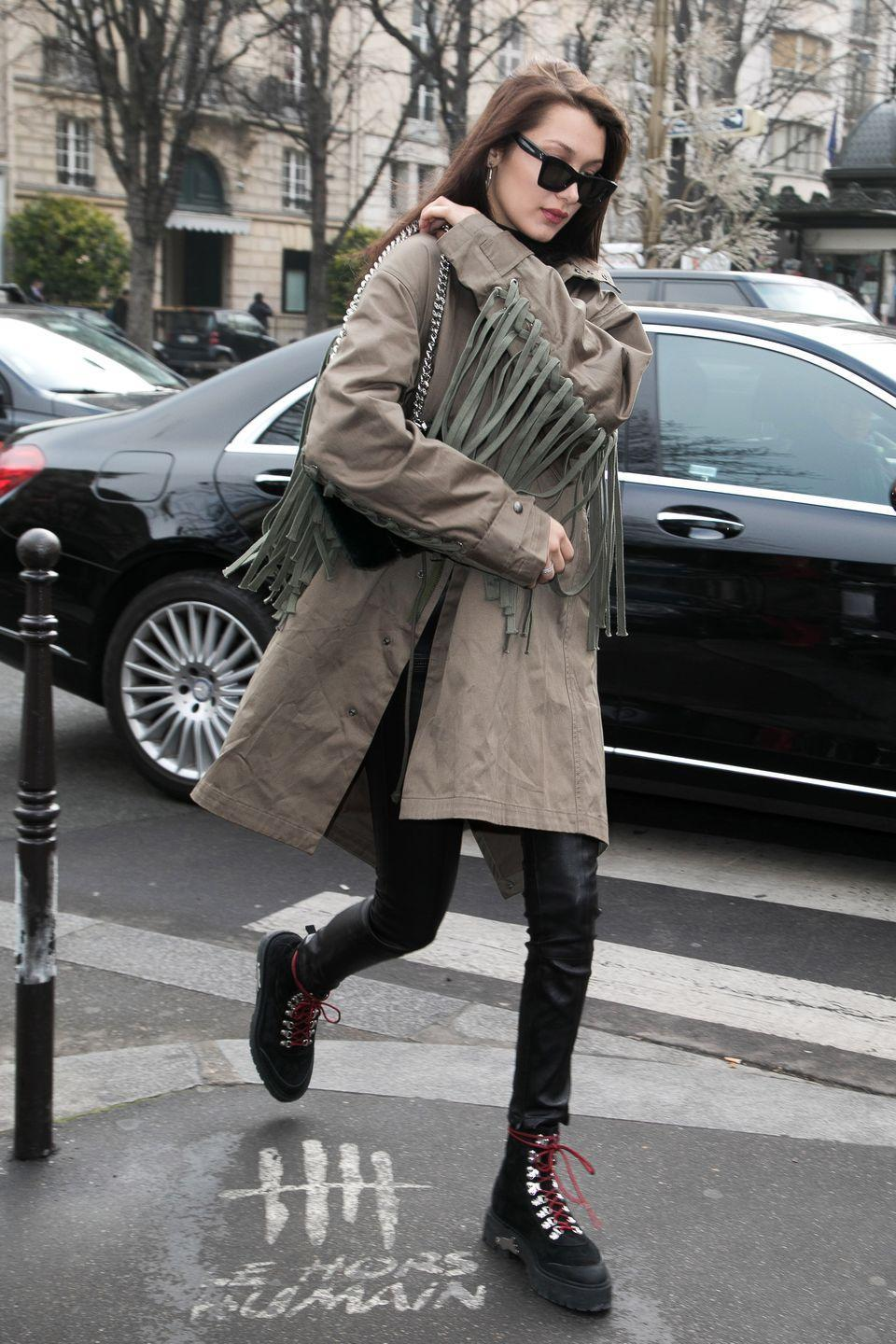 <p>In a fringed cargo jacket, leather jeans, lace-up combat boots and sunglasses while out in Paris.</p>