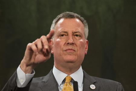 New York Mayor Bill de Blasio answers questions during a news conference at City Hall in New York