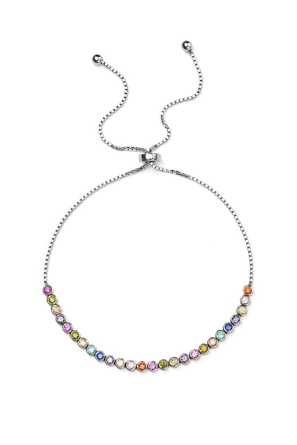 """<p><strong>Aqua</strong></p><p>bloomingdales.com</p><p><strong>$59.00</strong></p><p><a href=""""https://www.bloomingdales.com/shop/product/aqua-multicolor-stone-sterling-silver-slider-bracelet-100-exclusive?ID=3030399"""" rel=""""nofollow noopener"""" target=""""_blank"""" data-ylk=""""slk:SHOP IT"""" class=""""link rapid-noclick-resp"""">SHOP IT</a></p><p>If there's one piece of jewelry I wear every day, it's a silver bracelet. This option from Aqua is so thin, the chain looks nearly invisible. The brightly-colored stones, however, won't go unnoticed. If you're looking for a gift for someone special this spring (ahem, Mother's Day), present them this bracelet. </p>"""