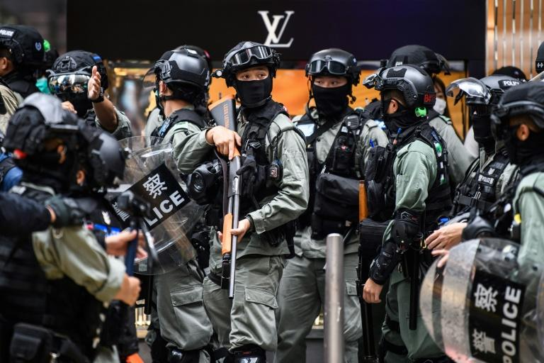 Riot police position themselves in Hong Kong in May 2020 as the city legislature debated a law that bans insulting China's national anthem